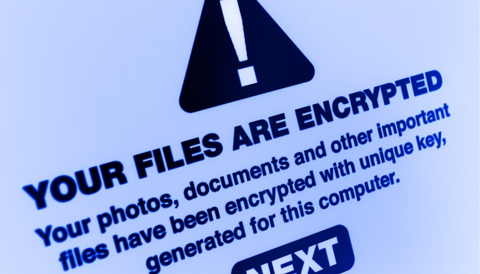 image of a computer screen with the words, your files are encrypted